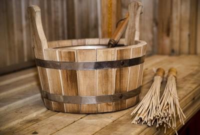 Sauna, bath accessories. Wooden bucket and sticks